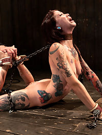 Intense Bondage Induces Severe and Electric Orgasms : This cute little tatted kinky slut comes back to Device to test her limits once again. It is fact that every girl looks hotter in bondage. Case in point, when your neck is chained to your ankles and you have to maintain the back arch or severely choke yourself. Her arms are the only things supporting her. That slowly gives. Can she sustain the position long enough to cum?Now that the back and neck have taken a toll, time for the arms and asshole. With her breathing constricted with the tight corset her arms are bound back then tied too an asshook. Her legs are kept spread with custom spiked spreader bars. This predicament is enough to keep anybody hard or wet. Folded over into a pile driver, Krystas legs are connected to electrodes for involuntary contractions to see her sweet ass bounce around. Her neck is strapped down to keep her from moving too much. After working up a sweat with her nipples tight to her toes her pussy is stuffed with an electric dildo. For the first time she experiences the inner pussy shock therapy with her orgasms.
