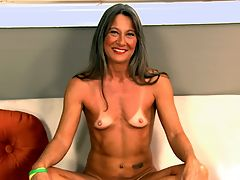Leilani Tells All and Shows All! : When this video interview opens, Leilani Lei, a 47- year-old amateur from Florida, is all folded up on a couch. Shes wearing yellow yoga pants and a tiny green top. Then she unfolds herself and stands up, showing off her tight, tanned body. And then she takes her pants off and shows off her tiny G-string and even tinier tan lines. My bathing suit is very tiny, Leilani reveals. I have a hammock in my backyard, and I also go to the tanning salon. Leilani is happy to show off her tan lines and more. She says she used to be shy, but shes not shy anymore. She quickly takes off her stitch of clothing and, man, those tan lines! And she giggles. And she loves to show off. And then she sits down on the couch and gets her legs all the way back so we can view her tiny, tight pussy and puckering asshole. Believe it or not, this woman used to be a loan processor. But dont think about that. Concentrate on her pussy as she spreads it. Concentrate on her feet, which our stud says are incredible. As jackable interviews go, this is definitely one of them.