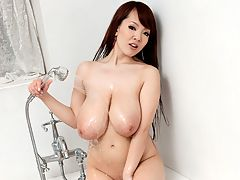 Shower Time : I enjoyed singing today, Hitomi says after walking into the bathroom. Shes got on a tiny bikini and high heels. Lets take a shower. Hitomi turns on the tap and stands under the cascading water. Looking at the camera with a coy expression, the living Tokyo toy-girl slips off her bikini top to reveal her sweet J-cups. You dont see many girls showering in their heels but Hitomi is not your average girl in any way, shape or form. In Japan, most people shower before taking a bath. Kicking off her shoes, Hitomi moves over to the bathtub to soap up, showerhead in hand, J-cup squeezed in the other. After she dries off, she dresses in a mini-skirt and SCORE tank-top but before she ends this video, she wants to do something else. Stay tuned for SCORELAND News about that blue bikini top.