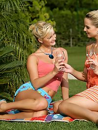 Aneta and Jenny - Alluring blondes have sex in garden