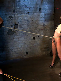Tiny sexy blond suffers heavy weighted nipple clamps and a crotch burner that keeps her on her toes! : Welcome Rene Phoenix back to Hogtied. This tiny sexy blond has an amazing tight, huge nipples and a beautiful smile.Rene is made to strip down to only her sexy high heels, then she is bent over and a butt plug is jammed inside her perfect little ass. The plug is tied in place with a tight crotch rope. Rene suffers and suffers hard as the SGT abuse her sexy little body. The cane is used floggers and heavily weighted nipple clamps. The shoes come off and Rene must stand on her very tippy toes or the crotch rope burns deep into her shaved slit. Predicament bondage at its best, as Rene must use all her calf muscles or her pussy takes the brunt of her weight!