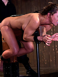CAUTION Extreme BDSM and Ass-Fucking with Ariel X : Scene 1Arms strapped to a cold metal pipe with one leg up and one leg down, Ariel gets her ass kicked, punched and thumped while she screams in agony. Then she gets a spreader bar hammered through her high heel cork shoes making her legs immobile, panty gagged and mouth taped shut. The best thing? She cant do anything about it! Out comes the cattle prod which sends Ariel flailing and finally she gets vibed and fucked with a dick on a stick until she comes all sexy.Scene 2With her hands taped into tight balls, Ariel is helpless on her hands and knees with her head trapped between two vertical pipes. Ms. Adams canes her strong, hot body, making her writhe in pain all over the ground. Then its time for a make-over! Ariel looks so pretty with a clothespin beard and eyebrows while her mouth and nose are stretched and clamped wide open like a cute little piggy! She is flogged, pinched, punched and dildo fucked in the ass which makes her come HARD.Scene 3Ass up, head down, Ariel looks like an expert jockey as she mounts a wooden beam with a hook up her ass. She gets choked and her ass slapped red while that hook punishes her with every move. Her toes and feet are tormented and tickled with the cane and rubber bands. Pussy lips are clamped and stretched open while Ms Adams fingers her until she comes hard. She laughs, she screams, she laughs, she screams. So much pleasure and so much pain.
