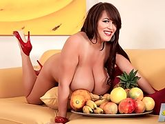 Leanne Peels It Off : Things a big-boobed girl can do with bananas and other fruits? Leanne Crow has some ideas. If banana eating contests ever return to their former glory in the UK, Leanne would win them all easily. I was a very late bloomer, Leanne says. I didnt develop until I was around 16 years old and then it was like they grew overnight. It was crazy because I was flat-chested throughout most of my schooling. I remember that I would make excuses not to go swimming with the other girls because I was extremely flat-chested and they all had boobs. I actually used to stuff my bra and I couldnt go swimming because it would be like I had boobs and then in a swimsuit, I didnt. No worries now. Leanne has become one of the most-popular-ever naturally busty babes in the UK.