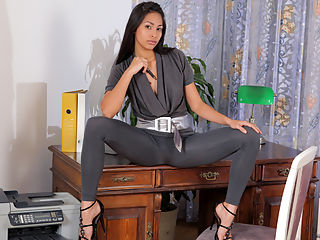 Petite Latina masturbates on her bosses desk