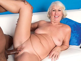 Cock juice for the 60Plus MILF : Jeannie Lou is dressed to fuck in a mini-skirt and fuck-me pumps, but the truth is, no matter what Jeannie Lou wears, shes dressed to fuck. What a nice fuckin cock, she says as she gives Lucass cock a rubdown. I cant wait to get that in my tight, fuckin wet pussy. Oh, shit! I need a little stress relief.br br This 61-year-old divorcee sure aint shy as she keeps up the fuck talk and stuffs her mouth with black dick while looking right into the camera. Yeah, thats it, Jeannie Lou! Show us what youve got! She slobbers all over Lucass cock and provides such commentary as, Oh, shit! Oh, fuck, yeah! Then she throws off her clothes and resumes the cock-sucking.br br Jeannie Lou gets rammed hard, cums hard and then lets us watch as a stream of cum flows out of her pussy. She opens her cunt wide with her wrinkled hands. Oh, I love that hot cock juice dripping out of my pussy! this former fashion-boutique owner exclaims. And thats all she has to say on the matter.