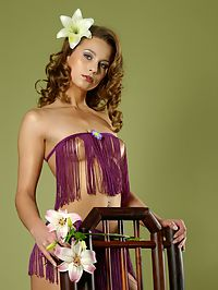Gallery Christin : Pretty teen posing naked and seductively on a chair