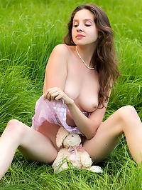 Naked teen posing : Sweet teen beauty strips in the field exposing her awesome nude body with perfect big tits.