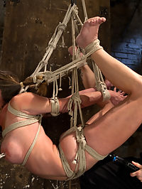 Part 2 - Felony Live Show - Most Flexible MILF : Amazing and incredibly flexible Felony endures a very challenging hogtie. We first start with her bound on the floor. Her elbows are bound together and pulled through between her legs up into a strict strappado. Her ankles are bound sky high up to a ring. Her hips are bound and secured too and her torso is pulled back nice and tight to display her beautiful breasts.Felony cums so easily and intensely that when she explodes in a cum fury she forgets her name, whats going on, everything. She is hoisted in the air and subjected again and again to incredibly hard orgasms.