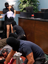 Brunette Bank Teller with Big Round Ass gets Gangbanged by Bank Robbers in her Naughty Fantasy : Beautiful brunette Sheena Ryder has a big ass, a banging body, and a dirty mind. While at the bank she drifts off and fantasizes about a bank robbery that ends up with her handcuffed and fucked in every hole at the same time. She cums so hard from getting fucked in the ass she loses all control and gives herself over to the thugs. In the end she is left handcuffed to the vault with a cum covered face. I guess in her fantasy they werent after the money afterall, just her wet holes!