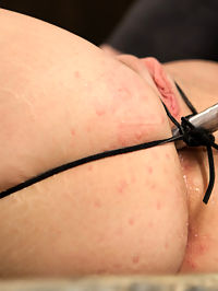 Bryn Blayne gets a smack-down into submission - Live Show Part 2 : Bryn is bound on a wooden box in an open pile diver position. Her thighs are strapped open and cinched to the box with black hemp rope. Her wrists and ankles are bound in leather cuffs and her forearms vet wrapped. Her head is encased in two gags - a head harness and plastic gag. She is pretty fucked.A metal tube is tied into her ass hole. Claire says this is an homage to Cyd and we begin to get curious. Being a smoker in real life, Bryn gets a taste of her own medicine with cruel cigar and ash play... and later on much larger flames. The more the bitch squirms, the happier Claire gets.
