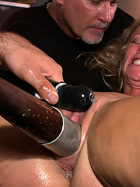 Sexy Big Tit MILF gets Ass Fucked by Strangers in Public! Squirting, BDSM, Bondage, Humiliation! : Simone Sonay is one tough MILF! Not only is she a filthy cock loving attention whore, but the bitch can take a beating. She loves to please, and today it ti s her aim to please Princess Donna, which she does very well. She has her ass paraded around the room, then clamps hung off her pussy lips attached to a bucket filled with water She gets cattle prodded on the pussy, fucked with a bat, ass and pussy fisted, fucked by strangers, three loads of cum in the face, manhandling, public humiliation, and more! What can I say, just watch it! Shes amazing!