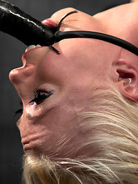 Lorelei Lee is Bent in Unforgiving Device Bondage : Sweet, seductive, blonde hair and blue eyed Lorelei comes back to Device for another serving of pain and predicament bondage with a side of hard black cock in her ass.SCENE 1Innocent Lorelei wearing a pretty pink dress with nails and eyeshadow to match gets crammed into metal. Bending over, her waist is secured in a pipe box and her neck is trapped parallel to her back preventing her moving up or moving her ass out of the way. Her wrists are bound above her head in thick leather cuffs strappado style that are attached to a metal frame. Her ankles are strapped in leather and spread wide too. Completely vulnerable, there is no way for her to escape having her breasts, cunt, or ass being played with. Ripe pickings.SCENE 2Her torso is strapped to a leather bar crucifixion style. Her knees are elevated to the height of her arms, straight in front of her and are also strapped to metal. Her ass is precariously balanced on a miniature perch. Her mouth is pried open with a plumbing gag. She... is... fucked. To better illustrate to Lorelei exactly how helpless she is, Claire goes after her feet with cruel piano wire. Writhing in pain, its clear there is no escape. Amused, the last thing on Claires mind is stopping...SCENE 3The ultimate in a bondage lovers predicament arsenal - Lorelei is bent into a severe back arch and stuffed in the mouth and the pussy with cock that she cannot escape. The leather straps are angled and held taut with chain. Her back is pushed into the arch with pipe and her mouth pried open with a spider gag with no rite of refusal to the cock in her mouth... cumming, breathing, terrorized, more cumming...