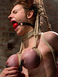 Big Titted Slut Iona Grace Suspended and Tormented on HogTied.com : Iona Grace. Gorgeous body, tough attitude, ready to go, was wanton for punishment in this update. She wanted it hard, with marks, and no mercy... be careful what you wish for!SCENE 1Iona is bound with her tits to her knees and wrists pulled high and harshly above her. Nipple and clit suction, arm pit caning, kicking, cumming. She is just getting warmed up and already is reaching her limit of enduring the pain and torment. She wants to please Claire so badly, but Claire is far from impressed.SCENE 2Bound against the brick wall, Ionas round ass is plump and just sticking out there waiting for torment. A nice cold ass hook is slid into her vulnerable asshole. Her neck is tied to her ankles and she is made to watch all of the pain and pleasure laid out before her.SCENE 3Her tits are bound in leather and her body in a HogTie. Laying down on breast bondage is pretty uncomfortable and Claire enjoys this fact and makes Iona writhe as much as possible on those tender tits. Challenging Ionas capabilities of endurance, she is suspended in an extremely difficult suspension.SCENE 4Iona is bound kneeling with her ankles to her thighs and her breasts and hair to a suspension point. She is hoisted up just by her hair and tits and lowered onto a sybian. The unforgiving machine winds up and gives her quite the ride in a sybian finish.