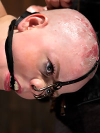 Alani Pi - Head Shaved Slut Live Show - Part 3 : This is part 3 of Alanis live Show. In preparation for the show we attach a nose hook to her cute little face and bind her in an elevated pose with her hands stretched up behind her back. She is pretty tough but this little piggy finally squeals when the whip comes out. The view of this pose is perfect for watching this slut gets pounded over and over by a dick-on-a-stick and ass red with corporal. We know this whore wants it bad so she finally gets to cum a few times.