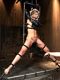 Chastity Lynn - Cum Begging Cunt - Live Show Part 4 : In the final chapter of Chastity Lynns Live Show, she is suspended spread eagle with speed rail and our ratchet strap system, leaving her cunt and as nice and exposed. Her arms are slipped into opera length leather bondage mitts and the drool from the open cone gag slips down her breasts. Mz Berlin steps in and warms her up with an extra special cunt flogging. Audrey Rose is then dragged in with elbows together bound in metal and required to service both Chastitys ass and cunt at the urging of Mz Berlin. Claire adds the cherry on top by hammering Chastitys ass with the flogger and milking what seems to be a million orgasms from this cum begging cunt for the finale.