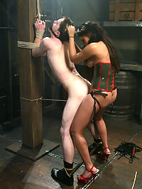 Militant Mistress Annie Cruz gets new recruit CJ into heavy submission with strict predicament bondage and painful domination. Then, as if inverted suspension in a straitjacket is not enough, Annie clips the mousetraps on his balls to really ramp up the energy before stretching his ass with an inflatable dildo. CJ finally takes it in the ass like a horny REDACTED while Mistress Annie teases his raging hard-on in a denial scene that leaves his balls blue and aching for release.