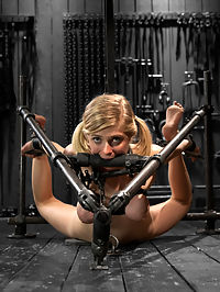 Blonde Cunt Penny Pax Subjected to Brutal Bondage : Penny is a special girl. Girl next door appearance, amazing curvy body, huge natural tits, blonde hair and blue eyes, and entirely unassuming personality... until you get this bitch in bondage and start manipulating her to your whim. In the first scene, Penny starts with her legs bound to a pole with leather straps and her arms bound strappado style up a metal pole. Her pain tolerances are immediately tested - to the limit. Claire puts as many nipple clamps as she can find on Pennys sensitive breasts and then adds an astounding amount of weight. Penny takes it like a champ. Upping the ante, Claire takes Penny and folds her over the metal her thighs are attached to, pulling her arms strict, taut, and far from her body. In scene two penny is in a v shaped hogtie predicament. Her forward momentum pushes her onto a metal bar gag and her tits are bound tightly holding up her torso. Claires interested in her tiny soft feet. Taking advantage of the position, we get to see just how much can be stuffed into her slut holes. In the final scene, Penny is inverted on the ladder. Her tits are tied with leather and greased up to a perfect shine. Claire decorates Pennys body with clothespins, layers it with pain, shows her affection with pushing Penny further down the cum rabbit hole.