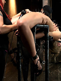 Chastity Lynn - Cum Begging Cunt - Live Show Part 3 : In Part 3 of Chastitys Live Show, her flexibility is pushed to the max in a crazy back arch. Her butt is smothered into a cube of pipe. Her ankles are shackled to the support poles in metal restraints. Her arms are pulled through the center of the cube and firmly attached with metal as well. In her mouth is a wooden bit gag wrapped in leather. Her hair is pulled back tight to prevent her from trying to sit up. The whole apparatus is on a turning basin so we can admire her from every view. Claire comes over and creates a predicament between Chastity and Audrey, the decoration model. Chastity gets clothespins cascading from her abdomen to her tits, attached to a string that is then handed to Audrey. Mz Berlin and Claire work Chastity up to incredible orgasms. Once she is right at the edge of the biggest one yet, Claire... well, you will have to watch it to find out!