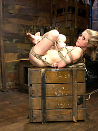 Innocent Penny Pax Faced Fucked by Mark Davis in Extreme Bondage : Beautiful, Blonde, blue-eyed Penny Pax is dragged in by her hair by professional sadist Mark Davis. Then strung up by one ankle with her massive tits tied to rocks the floor. Mark slaps her around and puts his cock down her little throat. He tickle tortures her and spits in her face. The little slut loves the extreme bondage and humiliation so much that Mark has to punish her for her insubordination. Then Penny gets tied to a post with her legs tied to a spreader bar, her breasts smashed between two tied bars and a crotch rope tied to the ceiling. First thing Mark does is pull down on the crotch rope to put her on her tippy toes. She gets her tongue confined by sticks and her nipples tortured with clamps ties to the spider gag in her mouth. With the crotch rope tight she is made to orgasm as Mark finger bangs her and presses a vibrator into her clit. Then she gets hogtied with an anal hook. Mark pulls into the air then crams his big dick down her throat. She has her fingers tied to nipple clamps and her hair in bondage. Mark has fun choking her with his cock then puts a gag on her and puts a huge dildo up her as and a vibrator on her pussy. Lastly Penny is suspended in the fetal position and Mark canes her feet and flogs her ass. He then crams his cock down her throat some more and pushes her to cum.