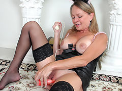 Hot and horny granny takes a break from her housecleaning to give her cock starved pussy an orgasm with a rabbit toy vibrator