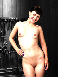 Katharine Cane vs Jack Hammer : Creamy alabaster skinned Katharine Cane finally makes her debut at Device Bondage. She is tough as nails and her pretty eyes get so wide when we subject her to the hellish torments that await her. In the first scene she is strapped into a crucifixion hogtie with leather straps on a metal pole. She is face planted onto an extremely uncomfortable metal grid cage. Jack takes his time working her over, letting the weight of the poles on her back and the hard bite of the cage underneath sink in. Just when she cant continue to endure, she is suspended and installed into an upright version of her predicament. Her weight slowly sinks down as the leather bites into her skin. Stripped of her dignity, the day is off to a great start. In scene two, Claire intricately crafted a metal ebi position where Katharine is strapped in a sitting position almost indian style with custom fittings fresh out of the shop. Her feet are trapped together with metal toe cuffs. In her mouth is a cruel metal gag secured both behind her and in front of her. Her legs are pried open and her wrists are bound behind her at the waist with the metal stock system. She can only look down and can barely see what Jack has in store for her. Can we say cattle prod? In the final position, Katharine is brought back to the crucifixion style that she started the day in with her hands bolted to the floor in metal restraints. Her neck and knees are fitted with metal and bound together so that if she struggles, she will jerk her head around. Her feet are placed in tight metal fittings and hoisted in the air, available for so many things. A nice big butt plug stretches her asshole wide... open... available. Jack expertly Dominates Katharine through the entire shoot. Pushing her limits, testing her trust, and terrorizing her. I would tell you what happens, but...
