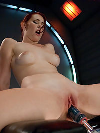 Long Legs, Firey Red Hair, Milky Skin and Machines fucking Her Pussy : This new local girl is getting gobbled up by every Kink site. Melody Jordan is hot and she fucks like she built the machines. She takes on The Queen to warm up and show off her long body with her sexy stripper -like moves, except the pole is a dildo and its grinding up inside as she slow dances with it. The Gynobot finds her g-spot and after a good deal of pounding, Melody leaps off in a violent orgasm. But perhaps the best scene is the final one with the Satisfyher as she spreads wide and open to the machine and then turns over for an amazing view of her great ass and into position to squirt which she does is a great finish.