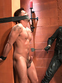 Dominic Pacifico in Bondage Hell : Master Avery has a seasoned slave tied up in his dungeon. Gagged and blindfolded, Dominic Pacifico jerks and pulls against the ropes as hes cropped. His cock gets hard and his balls get pulled causing the room to fill with his muffled screams. Avery means to test this boy today and to do so he hangs him from his back, arching it to an unbelievable degree. He makes Dominic suck his cock, then flogs him hard, and fucks his ass. Unsatisfied, Avery suspends him once more, this time in belts and shoves a fucking machine up his ass. With it put on full blast Dominic yells out for mercy. Avery takes the boys ass for himself again and cums all over his face through the head cage.