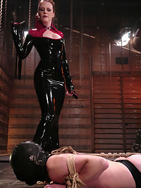 Latex Goddess Lydia McLane lords her power over slave boy rick as he squirms in an escape attempt from rope bondage while under the laughing Mistresses whip. A chilling sounds scene follows, and Lydia continues her humiliating onslaught by commanding rick to recite I like how my little pussy is getting fucked while reaming out his piss slit with the thick, steel rods. In the end, rick is suspended and fucked in the ass while Lydia strokes her gloved hands over his hard, aching cock. Maybe she will even allow him to come?
