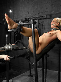 Anikka Albrite : Beautiful, blonde haired and blue eyed Anikka returns to Device for more. In the first scene, Anikka is bound tightly in the black canvas straight jacket and suspended in a hogtie position with leather wrapped around her ankles. To keep this bitch under submission, her knees are opened with the spiky sticks and her tolerances are tested with a heavy handed tazapper session. In the second scene, she is suspended pile drive style with leather straps. Sticky pads are attached to her tender ass and she is made to cum from spanking alone! In the final scene, Anikka is spread eagle with metal pipe. A metal collar keeps her head up and a fucking machine mercilessly pounds her cunt into oblivion.
