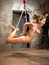 Audrey Rose Live Show - Complete Edited Version : Audrey is an amazing combination of flexibility, beauty, and likes harsh punishing bondage that makes her submit to our whims. Her live show is no exception. In scene one she is tied with her wrists together that are brought between her legs and affixed to a pole with a small wood platform. Her ankles are tied open with a pole and she is given a very uncomfortable wedgie bondage predicament. Her ass is warmed to a nice shade of red with a thorough hand spanking. In scene two Audrey is tied in a brutal breast to ankle hogtie suspension that transitions into a partial hair and breast suspension and then ends with her on the floor held up by her breasts, hair, and elbows. Her eyes roll back into her head as she is repeatedly subjected to extremely intense bondage orgasms. In scene three she is suspended by her ankles with her arms bound to a 2 x 4 crucifixion style. This naughty girl brought her own personal pain toy for Claire to use on her. It becomes evident that she has never quite used it the way Claire knows full well how to administer on her vulnerable arms and thighs. In the final position, Audrey is frog tied and placed on a chair to expose her tender bits. Claire adds a zipper to her thighs and goes after milking every orgasm this slut has out of her hole. All live... all for your pleasure.