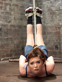 Jessie Palmer : Hot petite redhead Jessie takes it like a champ. In scene one she is suspended by her ankles, elbows, and hair ONLY! She loves hair bondage and moans with pleasure as her body sinks into the extreme suspension. Scene two, her elbows are bound together, up to strappado and she is placed into a forward bend. Presented with a torment scenerio, Jessies nipples are tied to her toes and she is brutally tickled. Scene three, she endures a hip back arch suspension with a pole jammed under her neck, keeping her head visible. Scene four, Jessie gets a floor worm tie with her wrists bound to a pole, and her hips partially suspended to present her ass. Again and again her relentless orgasms make her uncontrollably struggle against the unforgiving strict bondage.
