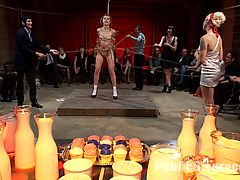 Amateur Model Disgraced at the Armory : Lorelei Lee orchestrates the perfect disgrace for sweet and innocent Kristine Kahill, covering her perfect natural body in icing and milk and making her a dessert for a a small group of armory regulars to enjoy. She is pounded hard in her mouth and pussy, made to cum, fucked by dicks on sticks, smothered in sweets, and sent to the shower to get cleaned off.