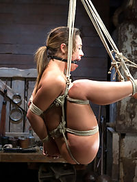 Kristina Rose : Hot tiny Kristina Rose gets placed in tough bondage and squeezed for cum. In scene one, she is bound with one leg against the beam and the other twisted behind into a hogtie. Her cunt is tied into a panty crotch rope predicament, leaving her labia exposed for Claire to enjoy. In scene two, Kristina is tied with her knees to a post and arms bound to her waist in a strenuous hogtie. She cums so hard she has tears of pleasure. In the third scene, she is suspended in an open legged ball tie and tickle tormented. A suction tube is added to her clit to make it even more sensitive. In the final position, she is bound to the beam and gets to joy ride the sybian with her legs spread nice and wide and a zipper to enhance the pain and pleasure.