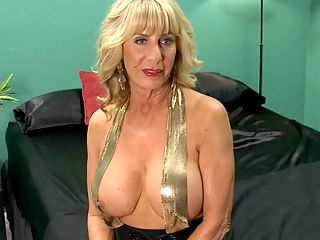 Shes nipplegasmic! The Phoenix Skye interview : Now its time to get to know Phoenix, a 63-year-old first-timer who was born on a big ranch in Oklahoma and now lives on a big ranch outside Dallas, Texas. Now, Phoenix has a lot going for her. Shes tall and blonde and sexy. But we have an idea that for most of this video interview, your eyes are going to be focused on her tits. Theyre big, firm F-cups, and Phoenixs nipples are barely covered by gold suspenders. In fact, her nipples sneak out once in a while. They have a way of doing that.br br My nipples are connected directly to my pussy, she said. When you play with them, they have a direct connection to my pussy. They make my pussy wet.br br Phoenix owns 10 pairs of nipple clamps and suction cups. She says she can have an orgasm just by touching her nipples and has even made herself cum by rubbing her nipples with one hand while shes driving.br br I like being assertive at times and being submissive at others, Phoenix said. I can be a romantic and I can be very naughty, too. One time, my boyfriend took me out for a wonderful dinner with wine, then he took me into an alley and fucked me. Im sure people saw us, but that made it even better.br br People are definitely seeing you now, Phoenix...every inch of you!br