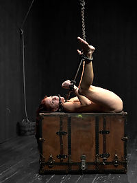Water play special! Tricia Oaks loves asphyxiation- we oblige. : Tricia looks stunning in yellow latex all chained up with her breast squashed by metal bars. We torment her nipples and subject her to the single-tail before giving her the Hitchi. She is strung upside-down in chains and repeatedly dunked into a tank of water. This kinky cunt loves breath-play and we top it off with a huge butthook and the electric zapper. Posed spread-eagle she gets the pussy pounding a horny kinky slut deserves.