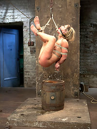 Welcome Sheena Shaw : Welcome the amazing Sheena Shaw to her first time here at Kink. We waste no time contorting this flexible tight blonde into outrageous bondage positions. First up, Sheena is suspended in an inverted straddle split suspension. This beautiful girl cums and cums and enjoys the pain and the pleasure of Claires predicament bondage. In scene two, she is tied in an ebi on a barrel, squirts everywhere in tremendously intense orgasms and is suspended in the air by her neck and ankles. Third, she is bound against a pole with one leg up in the air in standing splits. In the fourth scene, Sheena is bound against the wall in an open legged ball tie. Her nipples are bound to her toes and we get to see orgasm after orgasm squeezed out of this slut with anal and vaginal orgasms.