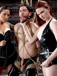 Making a Dominatrix : Mistress Claire has a new apprentice for the day. Fiona is new to MIP, but she is mean and horny enough to dish out a good round of erotic abuse to our slave for the say, Omar. Two mistresses torment Omar with strap on fucking, bondage and sex.