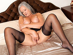 Elegant granny shows off her soft full curves and big boobs in sexy lingerie then sheds it all to pummel her juicy hole with a rabbit toy