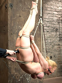 Bent : We love Darling not only for her amazing talent of flexibility but also how this hot cunt can just cum and cum and cum. Repeatedly her body is stretched to the max in outrageous positions. She cums like she is in pain, and all that does is turn us on. In the first position Darling is bound with her tits and ankles tied in a bow on a box. The weight of her torso presses her tits into the box uncomfortably. She is hoisted into the air and gets reminded that all she is good for is being under Claires Dominance. In the second position, she is bound in an open legged hairpin. Clamps on her nipples, breast bondage, and an anal hook all add a feeling of completeness to this helpless cum whore. Third, Darling is installed in a very challenging hogtie suspension with her tits bound to her ankles. Last, the almighty sybian always finishes. Darling gets thoroughly fucked into another planet getting a sybian ride she will not soon forget.
