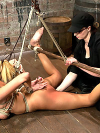 Katie Summers Tormented Cunt : Welcome beautiful, blonde, and tough Katie Summers. In scene one she is bound in an open hogtie with wood spreader bars bound to her ankles, and one under her elbows, lifting her torso. Her tits are bound and she is made to uncomfortably lay on them. Add a butt plug, a nice ass spanking, and foot torment and we get to see how much this bitch can squirm. In scene two Katie is bent bound doggy style. Her breasts are tied to her kneeling blocks to keep her chest down, while Claire gives her a reason to squirm. Later on, the breast bondage is traded out for a nice tight neck rope and cruel nipple clamps. She is pummeled in the cunt and squeezed for every orgasm she has. In the third and final position, Katie is bound kneeling, legs spread far apart with the wooden spreader bar and arms in what we call a prisoner tie position. They are hoisted above her head and bend this hot piece of ass into a beautiful back arch. Oil her up and this slut is just begging to have orgasm after orgasm taken from her until she is a mess of pleasure and incomprehensible moans.