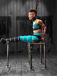 Defiled - Nikki Darling : Ebony stunner Nikki Darling is intense. She is an active and performing dancer and has the physique of a sleek panther in its prime. In scene one, she is given a perch. Sitting on an uncomfortable vintage metal tractor seat that is transformed into a mini throne, her whole body is zip tied together. Her elbows touch as vicious and inescapable hard plastic bites into her flesh all the way down to her feet... her lovely tender soles. Claire clips off the last zip tie, taking Nikkis shoes off and creates a uncomfortable predicament for Nikki that the cunt wont soon forget involving nipple clamps, wax, the cane, nipple weights, and twine from each of Nikkis big toes to her nipple clamps. In scene two, the panther is on the prowl. She is positioned in a low crouching doggy in metal and leather, and made to look like a panther ready to strike. The greedy whore cums from pain and Claire obliges her by using the single tail and a really stingy rubber flogger. With her amazing ass displayed in the air, a nice thick cock is rammed to the hilt into her more than willing ass hole. Orgasm after orgasms, she moans and writhes. Finally we test this bitch and push her to the max in endurance flexibility bondage. A cruel forward bend strappado suspension in leather. Claire goes after her feet with the cane, introduces harsh clamps to Nikkis labia and a nice anal hook to the booty. Orgasms are ripped from this helpless cunts body. So hot. So helpless.
