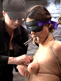 Scarlet Banks Cums to HogTied : Beautiful Scarlet is a tough bitch and Claire loves a challenge. In scene one Scarlet starts bound on her knees like a good girl blindfolded. Clothespins are added to her tongue and soon she is bound upright by her hair and the crotch rope. The only reward she gets is a vibrator through the crotch rope and all this hot bitch can do is cum. Second, Scarlet is bound spread on the floor with her legs up to the spreader bar. Claire applies a generous amount of clothespins to a zipper including cruel clover clamps to Scarlets nipples. Orgasms are wrenched out of this bitch and she is soon hoisted upside down into the air. Finally our bitch is bound in an uncomfortable chair tie with her nipples bound to her toes. The clover clamps from earlier are now on her labia and the cane is inserted in between them as a cruel counter weight pulling her cunt lips away from her body. Claire uses this as an opportunity to pleasure Scarlet with the vibrator over her pussy and a nice thick cock to fill her cunt hole.