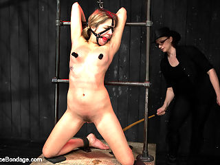 Lia Lor - Pretty Thing : Lia Lor is your girl next door sandy blonde beauty that gets served fresh and hard a challenging Device Bondage experience. In scene one, the pretty princess is bound in a strict leather arm binder and copper dog choke collar. Claire torments her with tickling then challenges this bitch to maintain position by binding her knees and ankles with the spike spreader bars. She attaches the choke collar to the floor with chain and our pretty princess is pretty well fucked in a painful predicament. In the second position, our tiny girl barely fits into an extremely small set of wooden stocks for the waist, wrist and a second set for the ankles. On her back she cant see anything that is about to happen. Claire delights in tormenting Lia with the cane and tazapper on her tender soles and cunt. Then Lia is flipped in the stocks, face down and ass up to receive a good fucking and wax over her ass, thighs, and feet. Finally, pretty princess cunt is bound in metal kneeling on the box with her arms above her head. Claires goal is to out orgasm this cunt and for her to beg for the pleasure to stop. Quickly Lia is overwhelmed with the amount of orgasms coaxed out of her slutty hole and clit and Claire shows no signs of stopping.