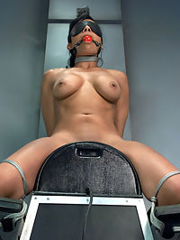 The Loaded Gun of Orgasms Hot Girl Machine shagged in Bondage : Beretta James is one of our favourite models. She is sexy, she is willing and she can shag. Today she gets tied up and fucked by the biggest guns in the fleet. She looks drop dead hot on the Sybian tied up with a blindfold and a gag.