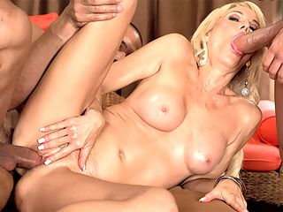 Ericas DP cunt-stuffing and ass-chute filling : So two guys are sitting on a couch, and a sexy MILF shows up.br br No, this is not the start of a corny joke. Theres no punch line. Theres just sexy 58-year-old Erica Lauren wearing a tiny bikini top and a short skirt and fuck-me pumps, and before long, shes on her back getting her firm little tits massaged and her hairy cunt spread and fingered, and then shes on her hands and knees taking one cock in her mouth and the other in her pussy from behind. She gargles that cock, trying to choke herself on it, but Erica cant exactly choke on it because she has no trouble taking it all down.br br Bur what happens next, you might ask? After Erica sucked their cocks and fucked their cocks, whats next on the agenda?br br Ass-fucking. But not just any kind of ass-fucking. DP. Double penetration. One in her pussy, one in her ass at the same time.br br The guys shoot their loads all over Ericas pretty face. They glaze her. You could call that the punch line. We call it the money shot. And this time, Erica doubles our pleasure.