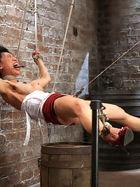Bitch Bound In Bag and Extreme Spread Eagle Special! : Welcome back tenacious Tia Ling. This bitch is one of the toughest Ive encountered. With delight she is subjected to some of the most intense predicaments her body can take. In scene one, Tia is bound in an extremely limited duration spread and neck play predicament. What makes this position so tough is with the feet elevated and the hands pulling back at an angle, she has no back support and only her ab and thigh strength keep her in place. A crotch rope is added and soon she starts suspending herself to avoid the torments being administered, which is super hot and sexy. So much that the barrel gets taken away entirely. The problem for her at this point is if she lowers her body too much, she will asphyxiate...Second Tia is bound in a face up fold, kind of like an ebi but very open. Bitch however is wrapped in plastic like she was found in a dumpster and left to hang like a piece of meat. The plastic adds a new challenge. It dulls her senses and makes the cane on her ass feel very different. A hole is cut to expose only her pussy and the nice butt plug in her ass. All she gets is anal orgasms from a slick thick cock in her slut whole. The bitch loves it, lapping it up, and cumming more and more. Finally all of the plastic is removed and she is left to suffer in her bondage.Finally Tia is bound in a discipline position where she has to will herself to stay still. She is extremely ticklish and between tickling and the cane, really cant behave. She is switched onto her stomach into an open arm reverse chicken wing hogtie. She looks far too comfortable and is switched into a very uncomfortable strappado and hoisted into the air in an intense 5 point hogtie suspension. Made to cum again and again she suffers and loves her bondage at the same time.