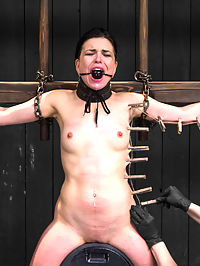 Juliette March - Insatiable Bondage Whore : Petite brunette Juliette has an intense gaze about her. Something that makes you think there are more behind those eyes... a true depraved pervert. No amount of bondage will satiate her need for restraint. She comes back again and again like a junkie chasing the dragon. I like her addiction and Im interested in feeding the monster.In scene one, Juliette starts out trying to endure the uncomfortable vertical arrangement of a compression bilbo stock pose. In her pretty little dress and fingers white at the knuckles with desperate pressure to alleviate her discomfort, bitch is fucked. She is laid down in the same stock assembly and challenged with a thorough ass paddling and intense foot torment. No time is wasted in getting in the greedy bondage whores cunt. Worked over and climaxed, she is completely helpless.Second, Juliette is bound in a mutli pose pipe inverted strap suspension. First, the swan dive. Her head is encased in a form fitting latex hood and pulled back into a nice arch. Her pussy protrudes clear as day and a stringent combination of pleasure and pain is administered to her questionable willingness. She is let out of the swan dive into a forward bend and is now made to demonstrate her whore abilities with her holes. Once thoroughly exhausted, she is laid down into a full worm inversion and left to feel her helplessness and binds.Juliette is then subjected to a spread sybian finish. Her torso is chained to the ladder and her gag is tied in uncomfortably by her ears. A nice tight leather posture collar prevents her ability to see the zipper that is about to be administered gleefully with every clothespin in the bucket. She rides the sybian hard with so many explosive orgasms that we lose count. Shaking, writhing, unraveling... never satisfied, always wanting.