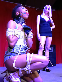 Nikki Darling DISGRACED ON STAGE FISTED, FOOTED, AND FUCKED!!!! : Tight bodied, Nikki Darling, is bound and gagged, fucked, footed, and fisted on stage in a divey bay area bar. Lorelei Lee parades her sex toy around for the crowd not only to see, but to touch, and to rip off all her clothes! Lorelei and Ramone cane and flog her as random people spank her on stage. Clamps are applied and Nikki begs for more whilst adorning a collar, bound forearms and biceps, as well as a leash made of rope. Ramone is waiting to shove his giant cock into all of Nikkis holes, but not before she is hoisted onto the bar and videotaped while being fisted. But, fisting is just a warm up for Nikki, She then bends backward over the bar and deep throats Ramones huge wanting cock. Her pussy is plowed on top of the bar and then taken over to a booth where she buries her face downass up into the crotches of the bar patrons!! Ramone gives it to her like a PRO while Lorelei Lee continues her sadistic humiliation with the flogger and cane.