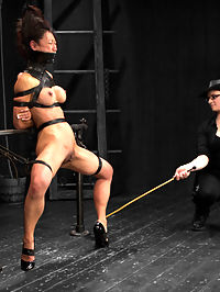 Tia Ling - Tormented WHORE : Tia Ling has been around the block once or twice. This hot Asian delight is back for more and submits to extreme torments from Claire Adams. In scene one, Tia is bound in the metal bilbos at the neck, wrists, waist, and ankles kneeling on the hard wood floor. Unable to move much in her entirely inescapable bondage, Claire dishes out the torments DeviceBondage style. Tia gets a tight transparent latex hood wrapped around her face with a nose hook and plastic ring gag. The pain play after the predicament is playfully administered and finishes out with this bitches knees being warmed up by a cruel pile of rice. Scene two, Tia is bound in a leather grand plie. Her shoes are taped on, so she cant kick them off. Her neck and face are laced into a posture collar. Electrical tape is wrapped tightly over the mouth. Her hair and only two thigh straps keep this bitch elevated. She suffers beautifully as Claire canes Tias tender cunt, and cums hard when made to. Finally Tia is bound in an intricate metal forward bend. Her holes are stuffed with four fingers each, cum wrenched from every part of her straining body and intense suffering... for our pleasure.