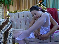 Annie wearing sexy nylons : Annie is obsessed with expensive hosiery, so today she chooses to put on her milky nylons with a wide lace top, and she will clip them to a pretty rosy girdle. The babe rolls them up so tantalizingly slowly you can hardly bear this naughty nylon tease. She carefully smoothens the stockings on her legs before admiring herself in the mirror. Will those white stockings match her red dress?